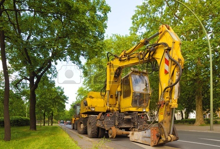 8684499-hydraulic-concrete-breaker-parked-on-a-residential-road-a-8-weeler-dump-truck-is-equipped-with-concr